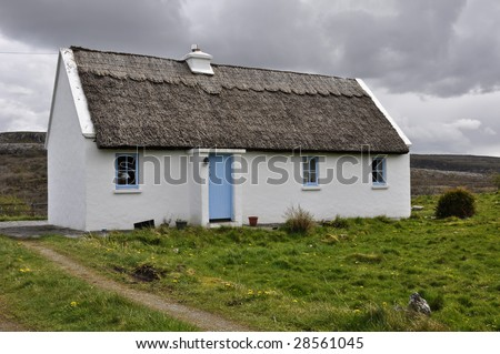 countryside rural cottage in a field