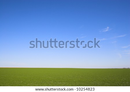 Countryside surrounded by colorful fields and meadows - stock photo