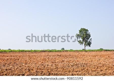 Countryside View of Furrowed Farmland - stock photo