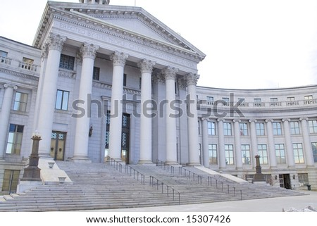 County courthouse with old style architecture and pillars - stock photo