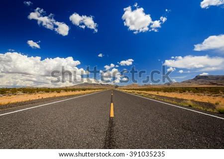 County Highway 91Littlefield, AZ 86432, USA. Endless road in the desert of Arizona. - stock photo