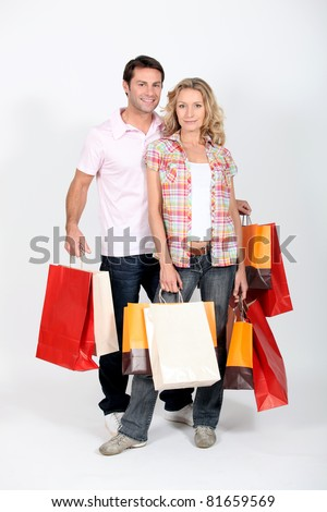 couple after a crazy shopping - stock photo