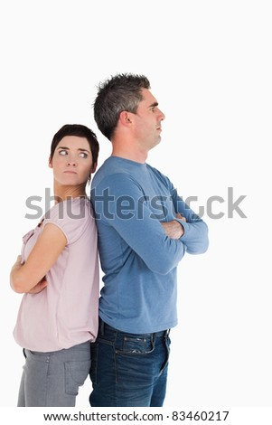 Couple after an argument with the arms crossed