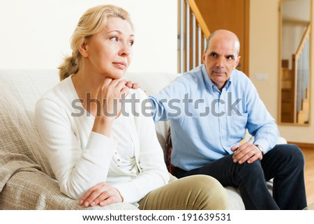 Couple after quarrel in room at home  - stock photo