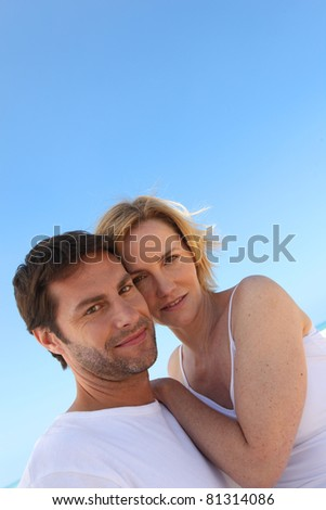 Couple and a blue sky - stock photo