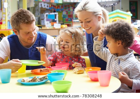 Couple and children playing with toys - stock photo