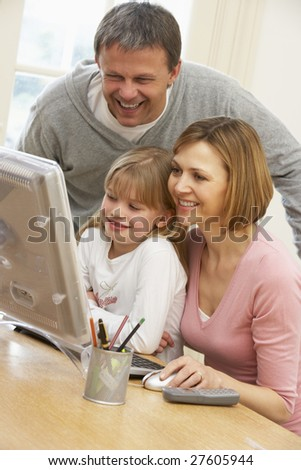 Couple And Daughter Using Computer - stock photo