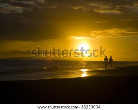 Couple and Hawaiian sunset - stock photo