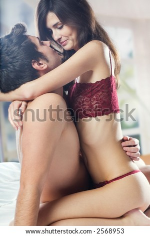 Couple and hugging on bed in bedroom, in passion - stock photo