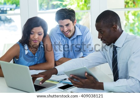 Couple and real estate agent discussing together at home - stock photo