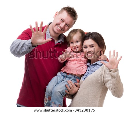 couple and their little daughter with palms up isolated on white background - stock photo