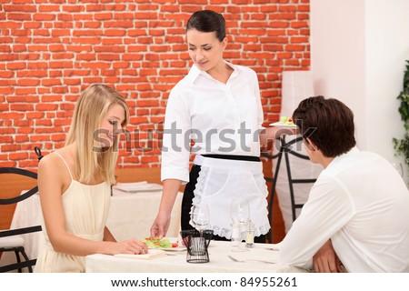 couple and waitress at restaurant - stock photo