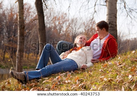 couple are lying on grass