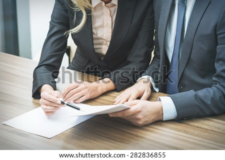 Couple are negotiating the contract. A concept of the teamwork in the legal firm. - stock photo