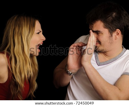 Couple arguing, girl yelling at her boyfriend - stock photo