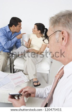 Couple arguing in front of financial adviser
