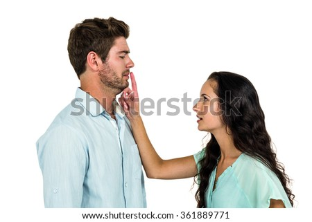Couple arguing while standing against white background - stock photo