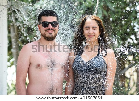 couple around water drops on blur green  background