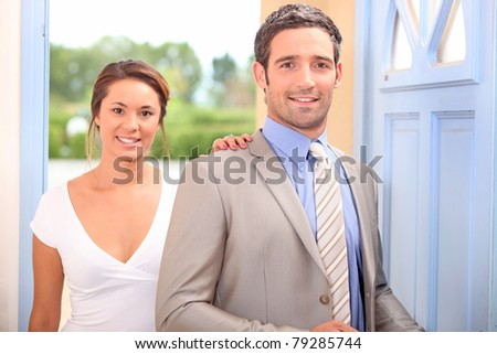 Couple arriving home - stock photo