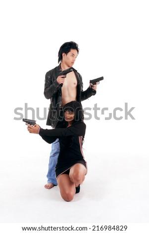 Couple Asian man biracial black Hispanic Latina Puerto Rican woman detective secret agent criminal with gun on shooting alert - stock photo