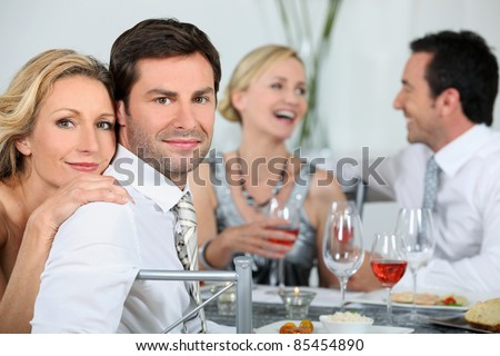 Couple at a dinner party - stock photo
