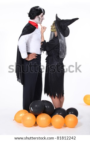 Couple at a Halloween party - stock photo