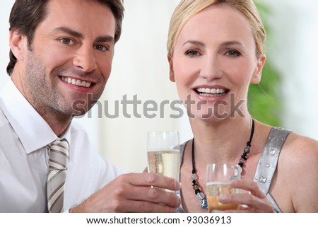 couple at a party - stock photo