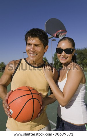 Couple at Basketball Court - stock photo