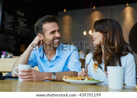 Couple at cafe talking during lunch - stock photo