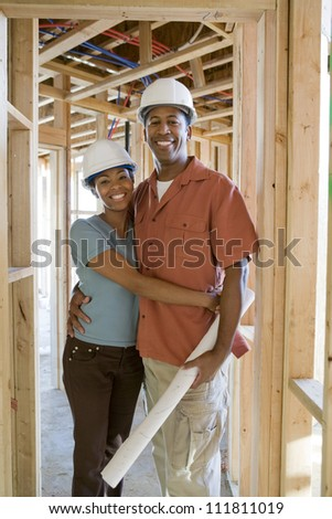 Couple at construction site