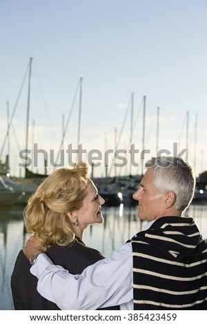 Couple at harbour - stock photo