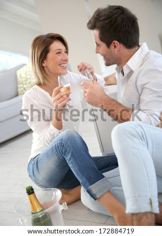 Couple at home celebrating new house purchase - stock photo