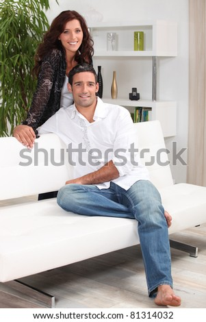 Couple at home in front room - stock photo