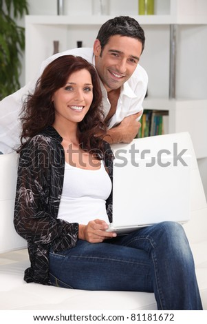 Couple at home in their living room - stock photo