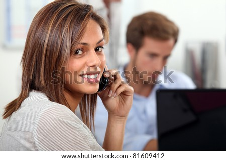 Couple at home with laptop and cellphone - stock photo