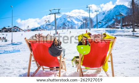 Couple at mountains in winter - stock photo