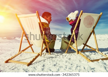 Couple at mountains in winter, Meribel, Alps, France - stock photo