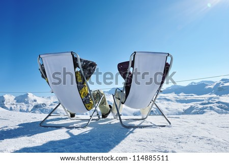 Couple at mountains in winter, Val-d'Isere, Alps, France - stock photo