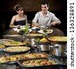 Couple at self service restaurant - stock photo