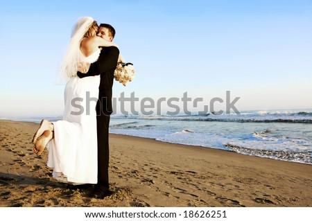 Couple at their beach wedding - stock photo
