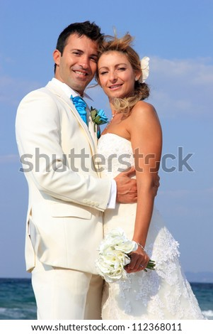 Couple at their beach wedding in Greece - stock photo