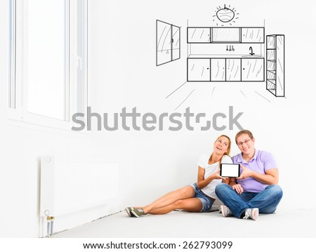 couple at their new empty apartment - stock photo