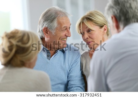 Couple attending group therapy - stock photo