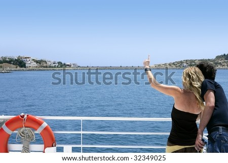 Couple back looking turquoise blue sea in vacation cruise boat - stock photo