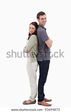Couple back to back against white background - stock photo