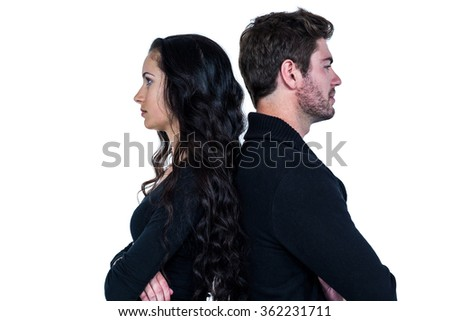 Couple back to back not talking after an argument on white screen - stock photo