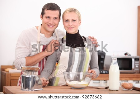 Couple baking together - stock photo