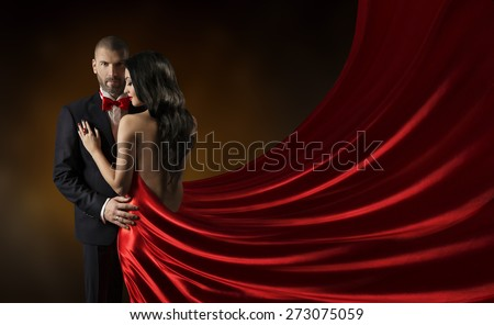 Couple Beauty Portrait, Man in Suit Woman in Red Dress, Rich Lady in Gown, Waving Silk Fabric  - stock photo