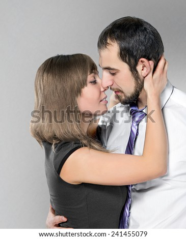 couple before kiss posing at studio - stock photo