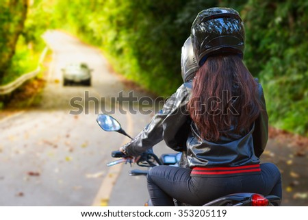 couple biker riding motorcycle in asphalt road - stock photo